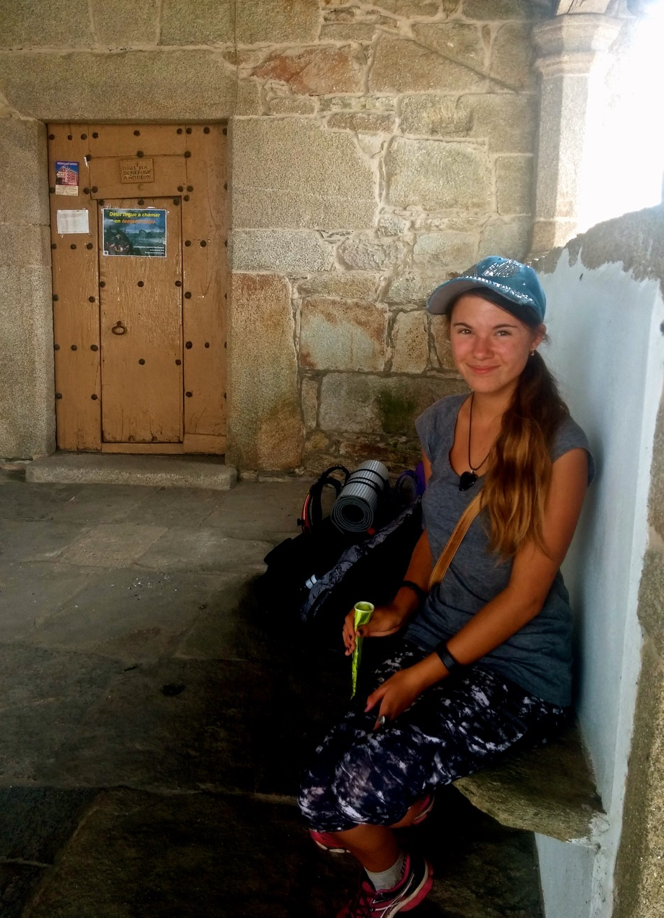 Reka resting at 18th century Galician church with Icy pole